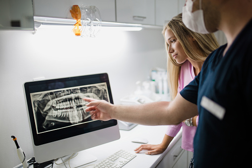 Doctor showing patient digital x-rays on computer screen at Kurt A. Gibson, DDS, PA in Winston-Salem, NC